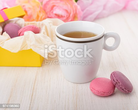 istock Cup of tea on a wooden table. 974198360