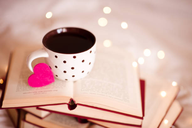 Cup of tea on books stock photo