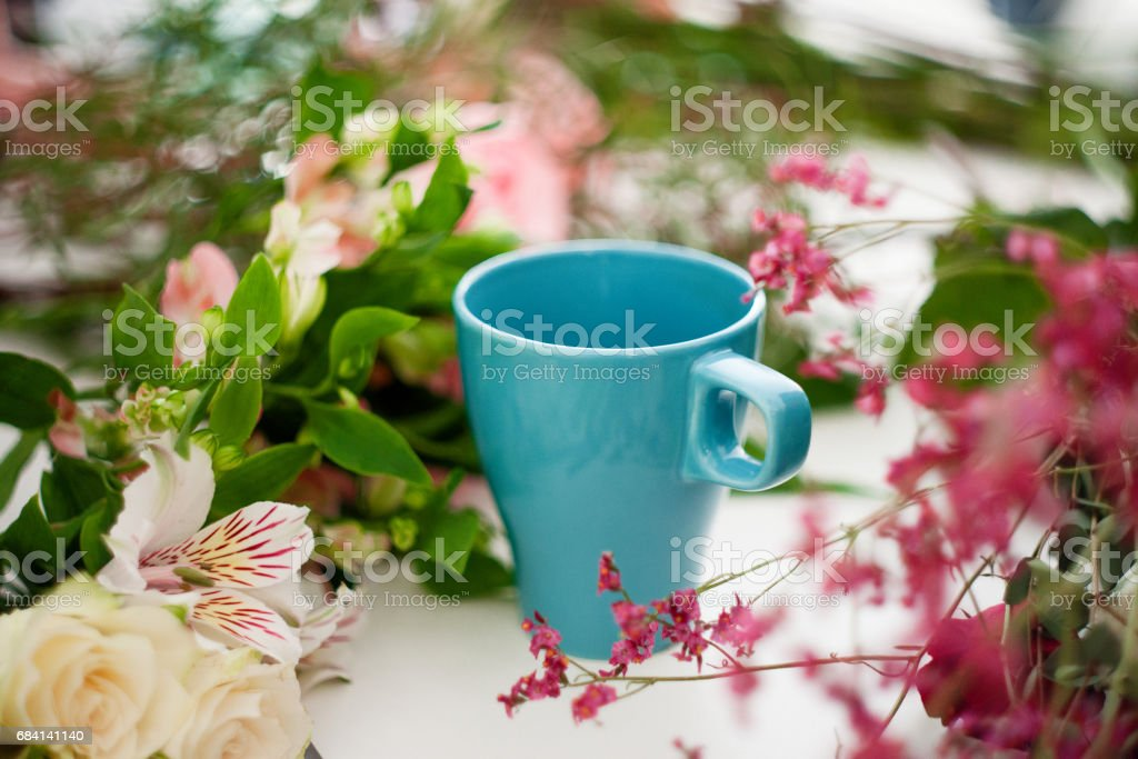 Cup of tea on the table, relax. Workshop florist, table with flowers, still life. Soft focus zbiór zdjęć royalty-free
