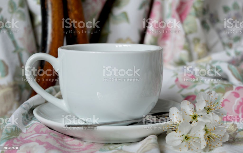 cup of tea on vintage textile background with cherry flowers Lizenzfreies stock-foto