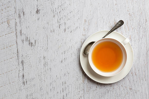 Cup of tea on white background, top view point stock photo
