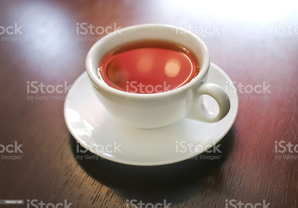 Cup of tea on wooden table, macro royalty-free stock photo