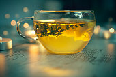 Cup of tea, thyme branch, lemon slice