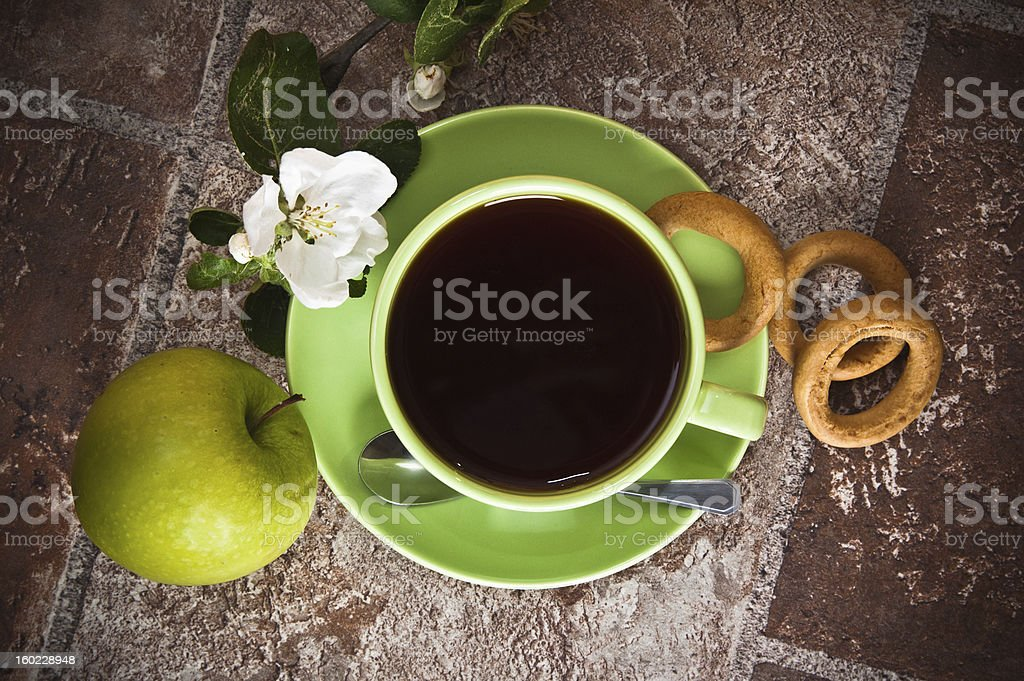 Cup of tea with an apple royalty-free stock photo