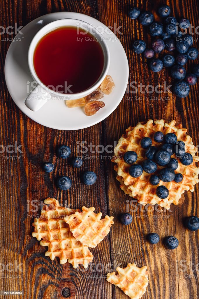 Cup of Tea with Belgian Waffles and Blueberries. royalty-free stock photo