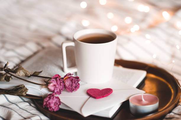 Cup of tea with book stock photo