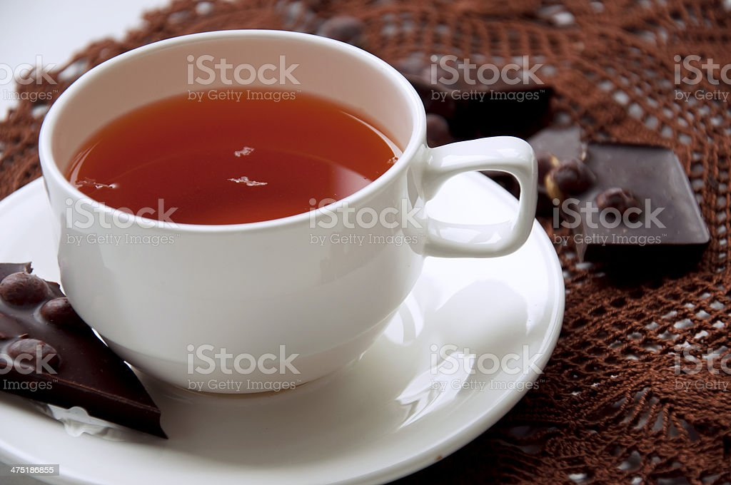 Cup of tea with chocolate royalty-free stock photo