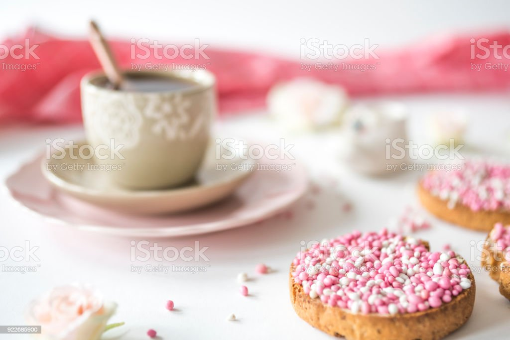 cup of tea with crispy rusk with traditional Dutch food pink muisjes, aniseed, for celebration birth of a daughter stock photo