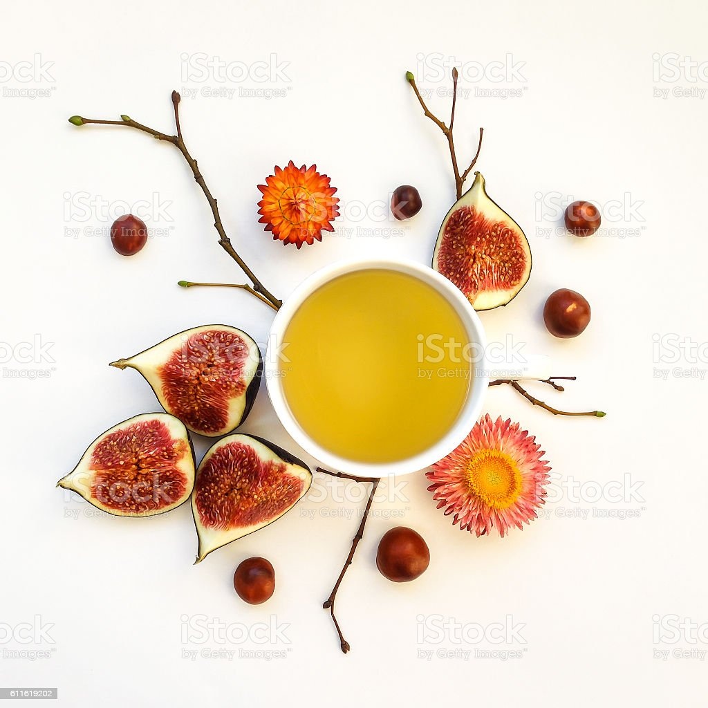 Cup of tea with figs. Autumn decoration. Flat lay stock photo