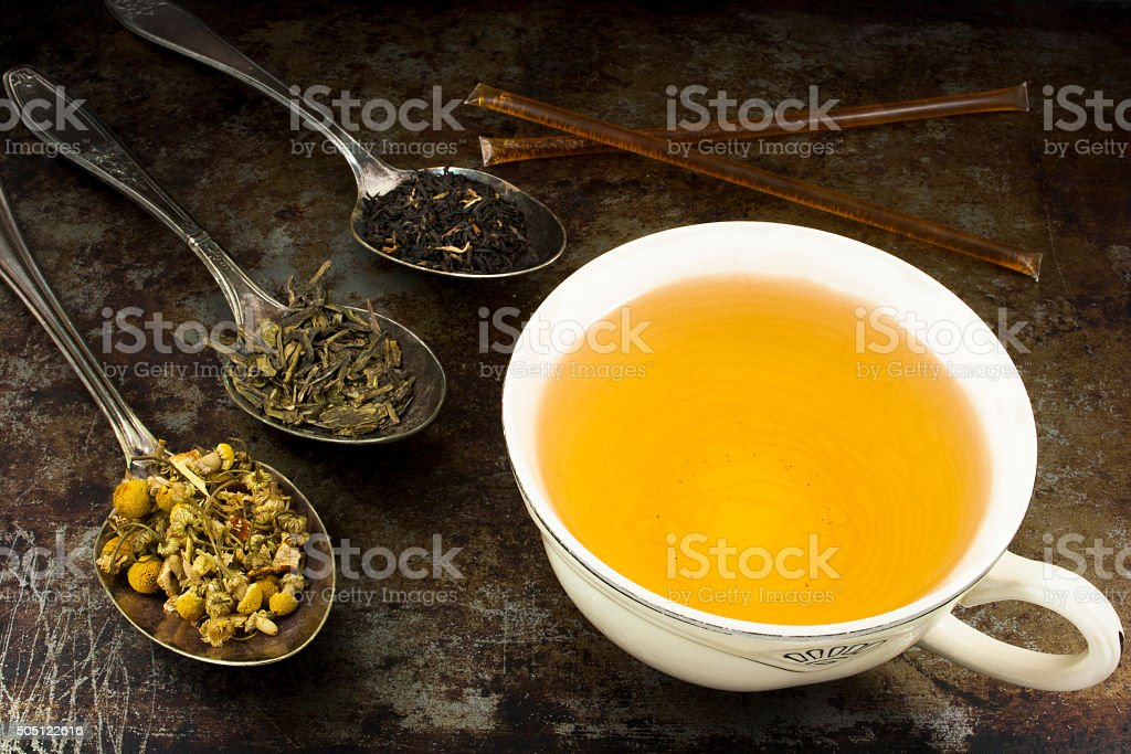 Cup of tea with leaves and honey stock photo