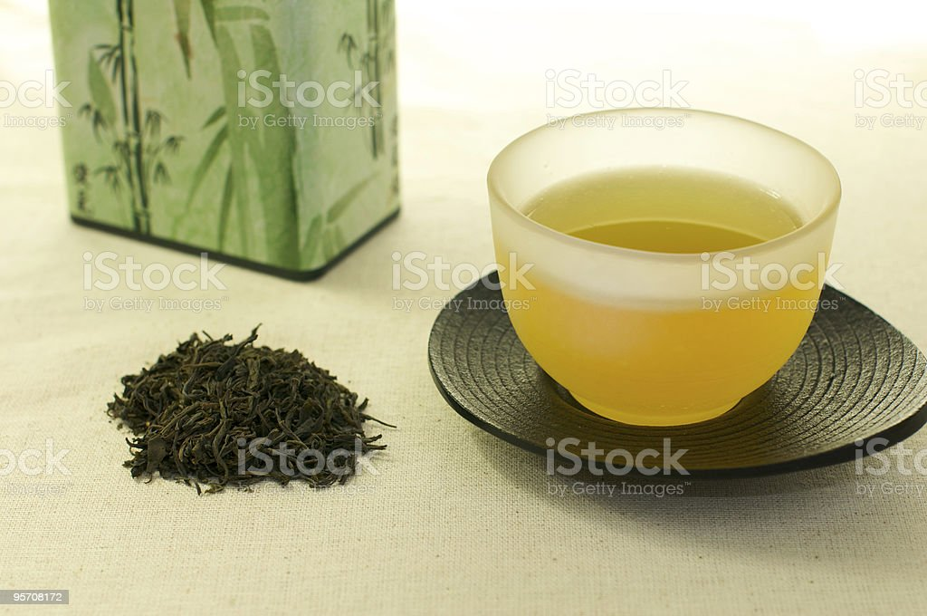 Cup of tea with leaves royalty-free stock photo