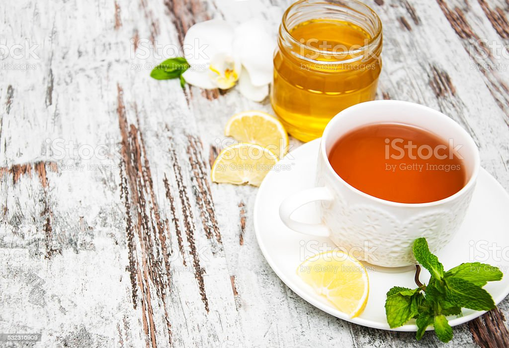 Cup of tea with lemon and honey stock photo