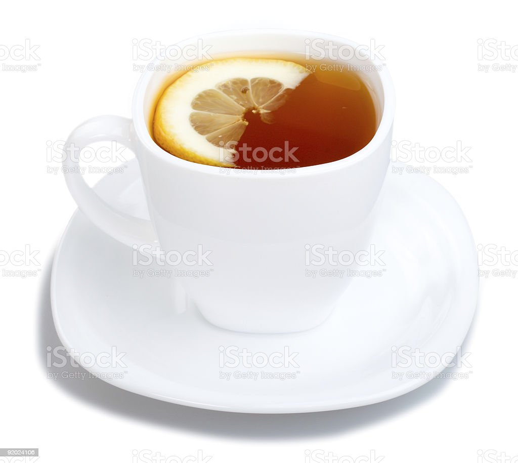 cup of tea with lemon and saucer on white royalty-free stock photo
