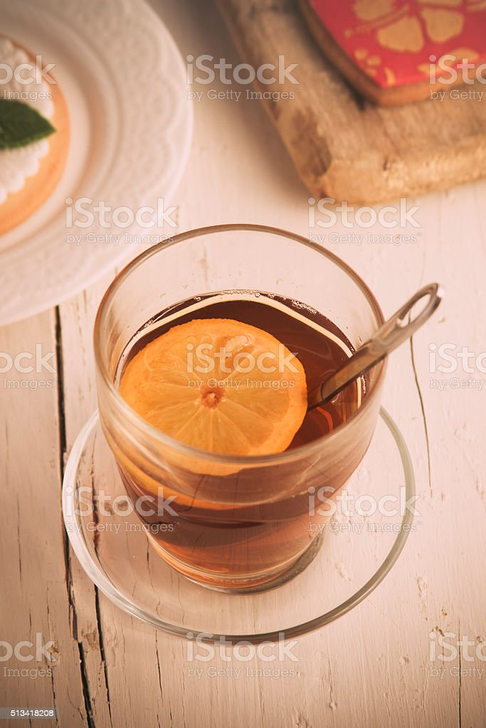 Cup of tea with lemon in the morning stock photo