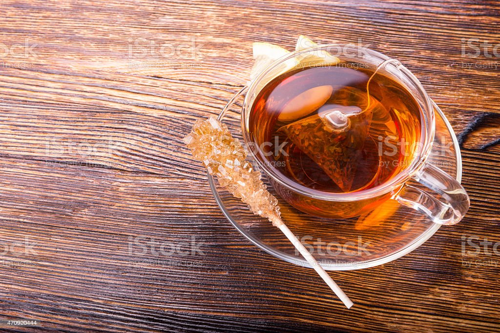 cup of tea with lemon on wooden background stock photo