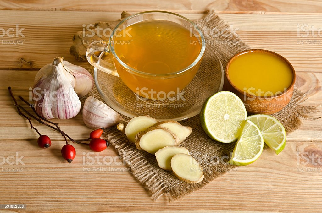 Cup of tea with lemon slices and ginger stock photo