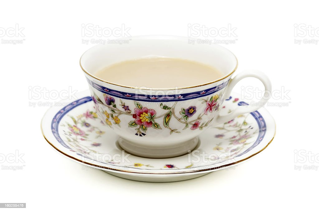 Cup of tea with milk on white stock photo