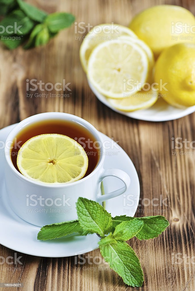 Cup of tea with mint and lemon royalty-free stock photo