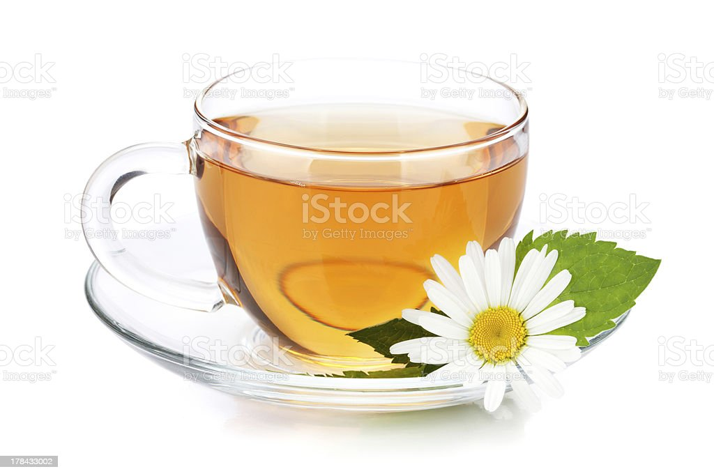 Cup of tea with mint leaves and chamomile flower stock photo