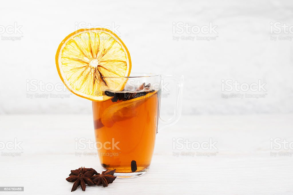 Cup of tea with orange and cinnamon on white stock photo