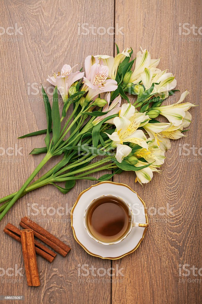 Cup of Tea with Orchid decoration royalty-free stock photo