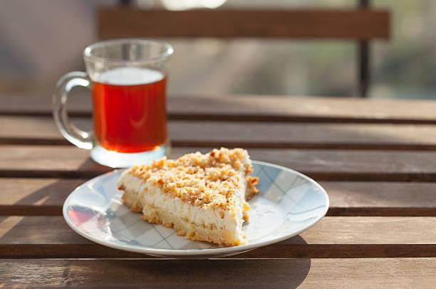 cup of tea with piece of cake. - käsekuchen kekse stock-fotos und bilder