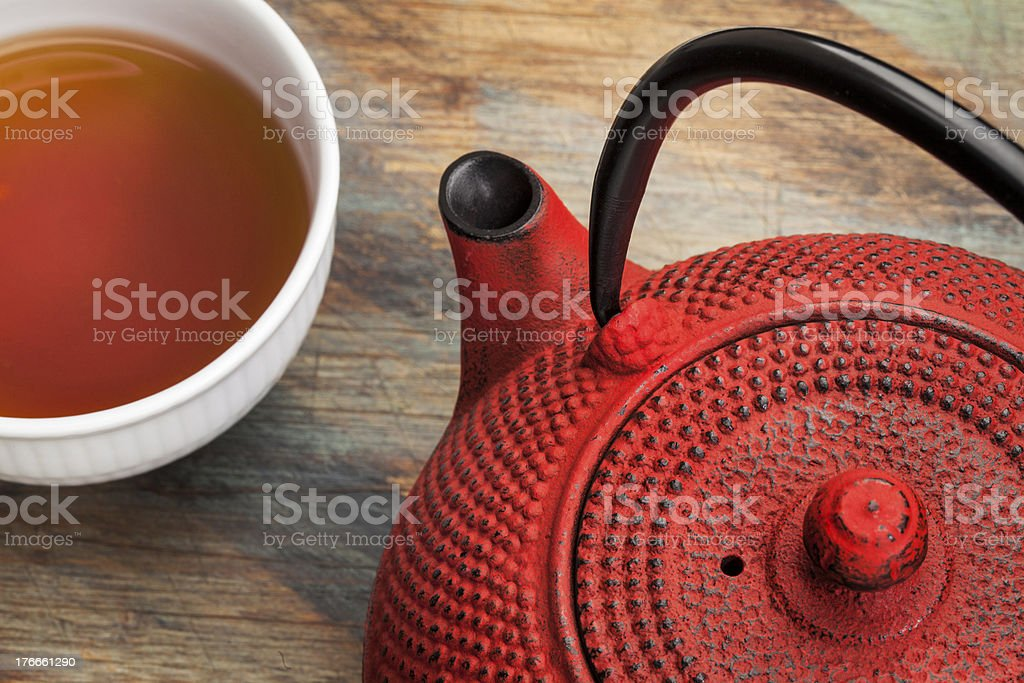 cup of tea with red tetsubin stock photo