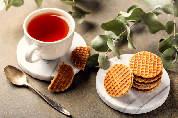 Cup of tea with syrupwaffles cookies stock photo