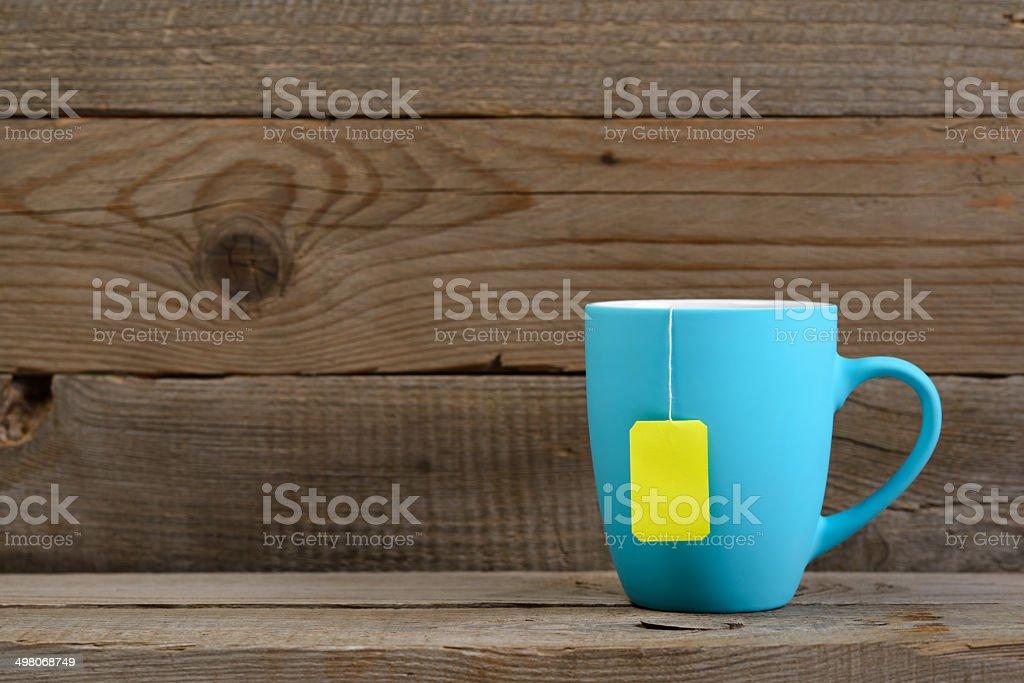Cup of tea with tea bag stock photo