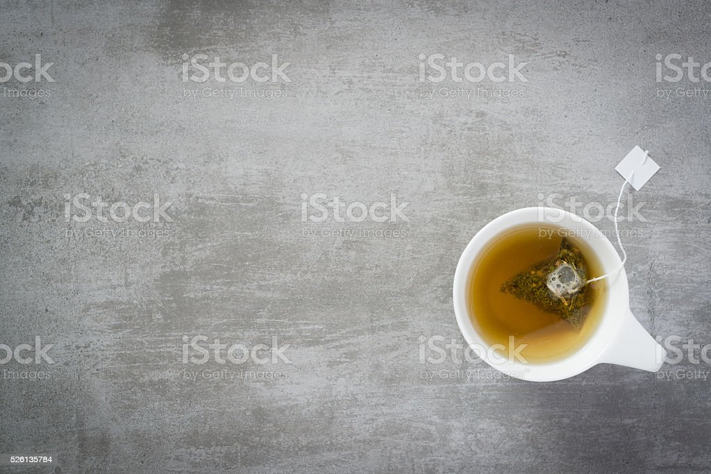 Cup of tea with teabag stock photo