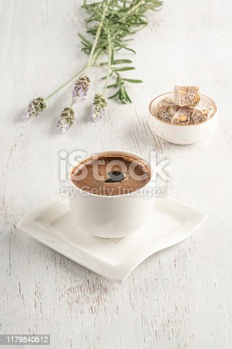 A cup of Turkish coffee and delight on a wooden table