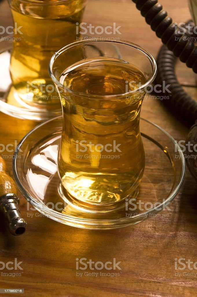 Cup of turkish tea and hookah served in traditional style royalty-free stock photo