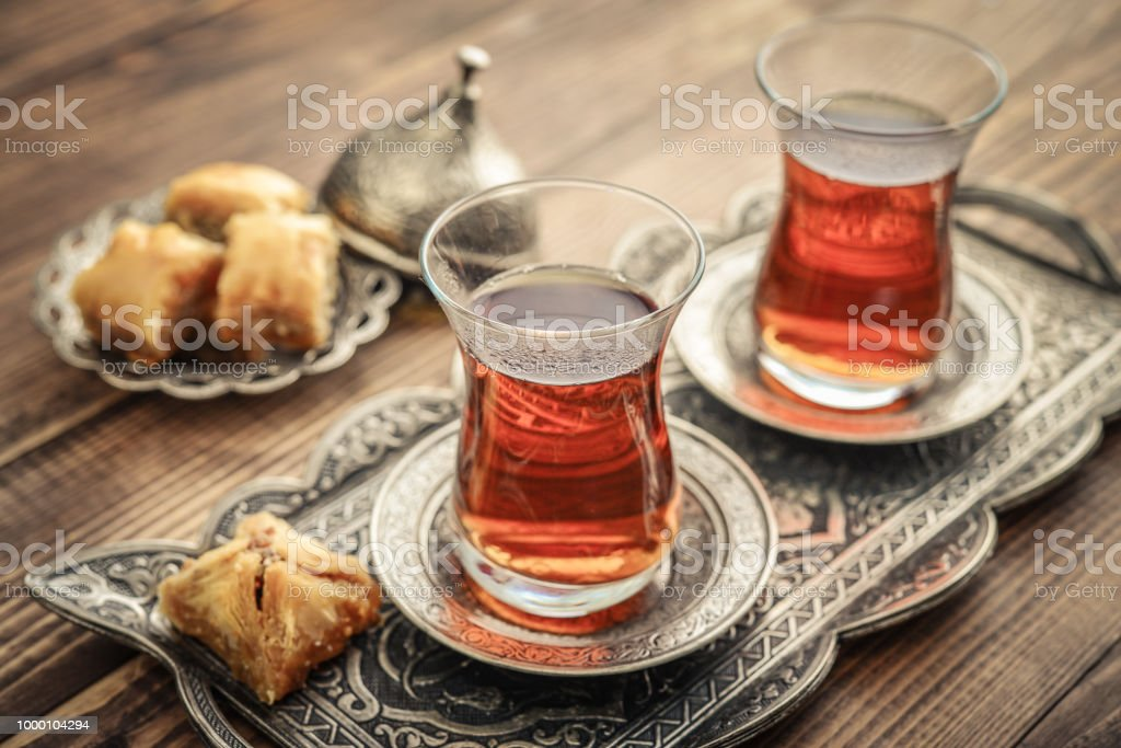 Cup of turkish tea served in traditional style with turkish delight...