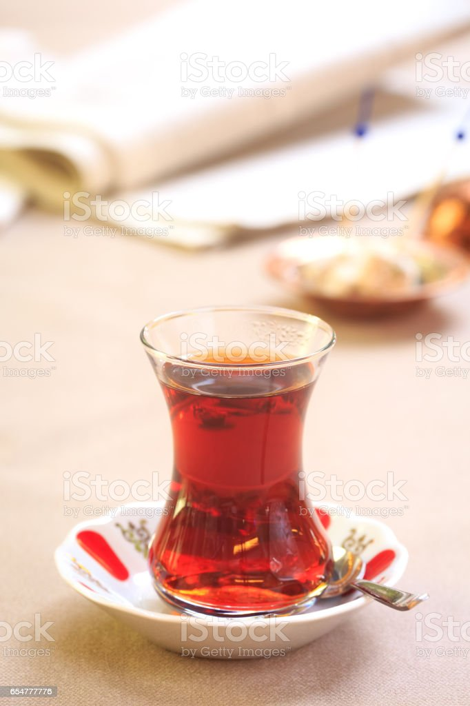 Cup of turkish tea with locum on oriental plate. Concept of turkish...