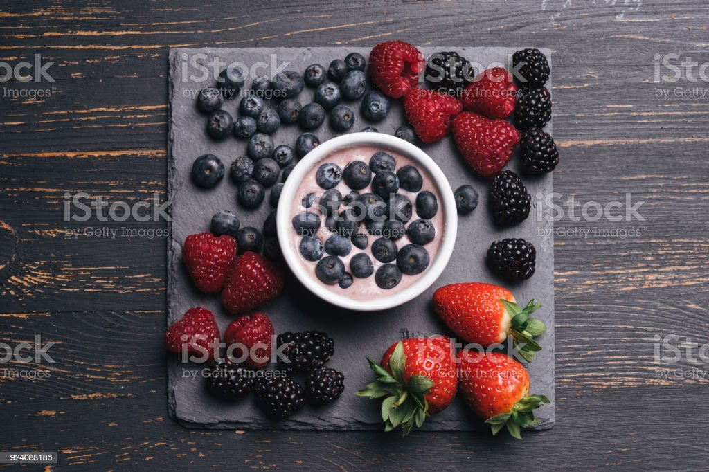 Cup of yogurt with berries stock photo