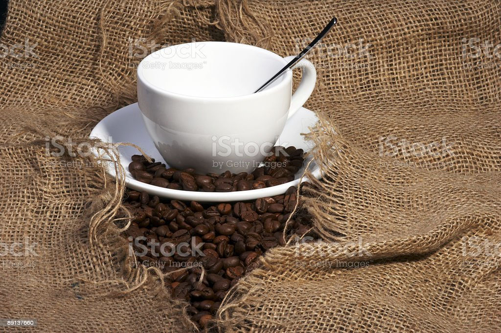 cup on burlap stock photo