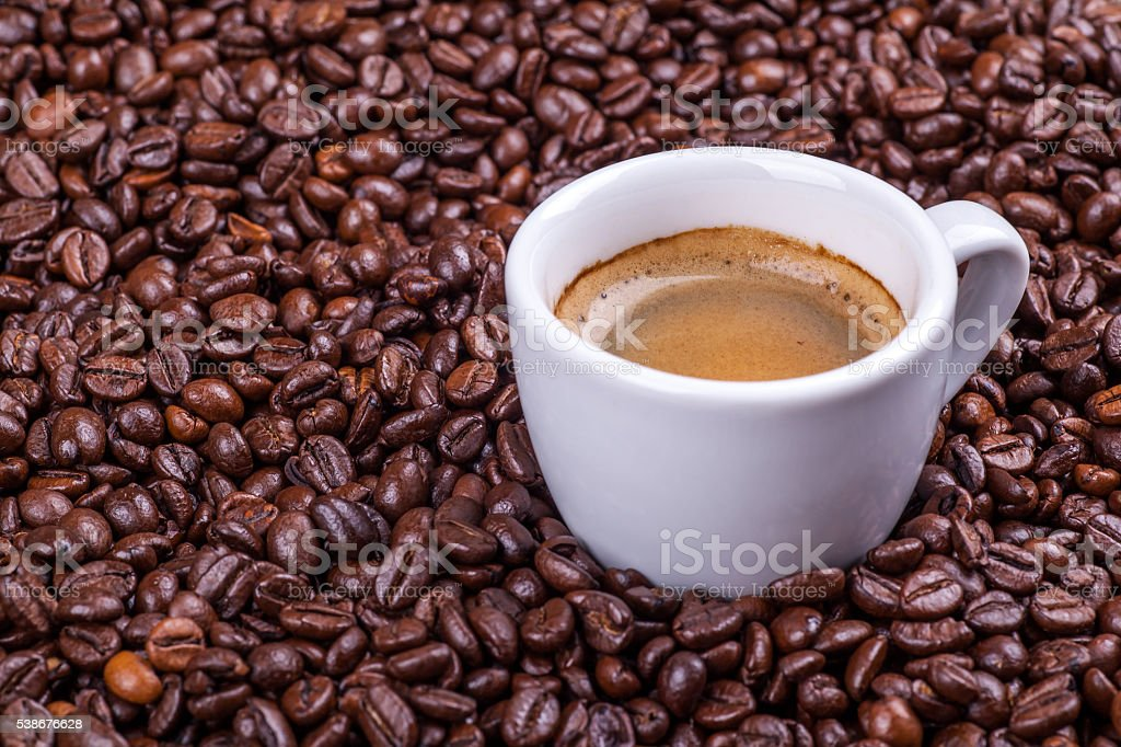 Cup on coffee beans stock photo