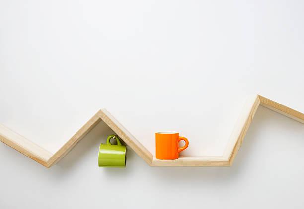 cup on wooden shelf - offene regale stock-fotos und bilder
