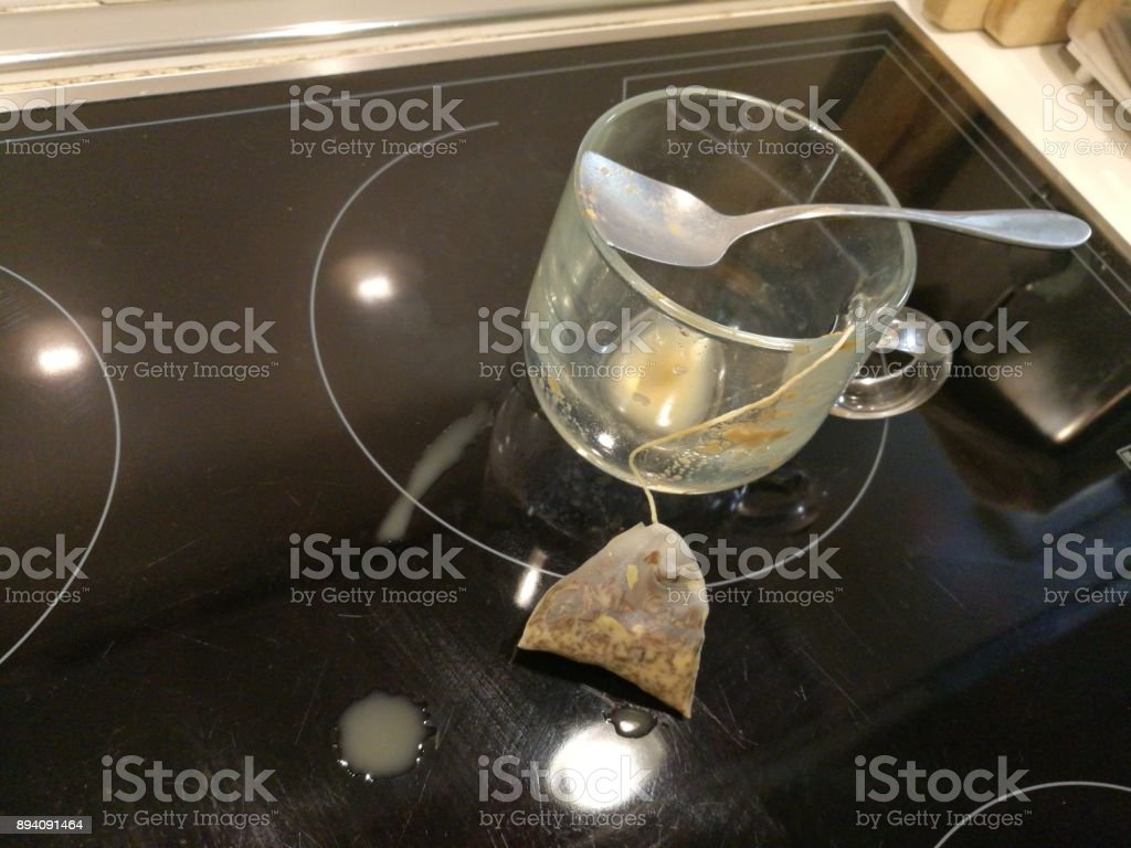 A cup with a tea bag. stock photo