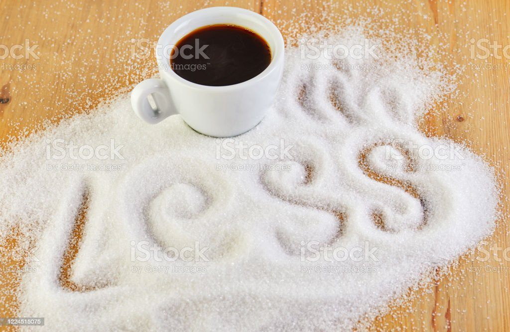 Cup with coffee and the words Less, suggesting a diet and health concept. Copy spice Cup with coffee and the words Less, suggesting a diet and health concept. Copy spice. Backgrounds Stock Photo