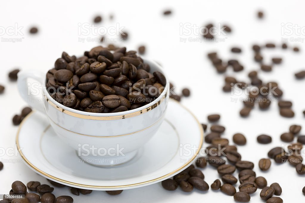 Cup with coffee beans on white background stock photo