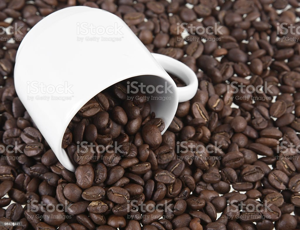 Cup with coffee grains royalty-free stock photo