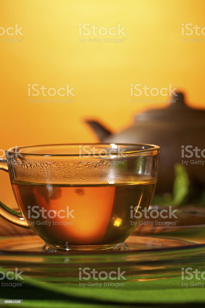 Cup with greean tea and clay teapot royalty-free stock photo