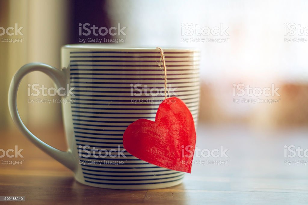 Cup with heart shape stock photo