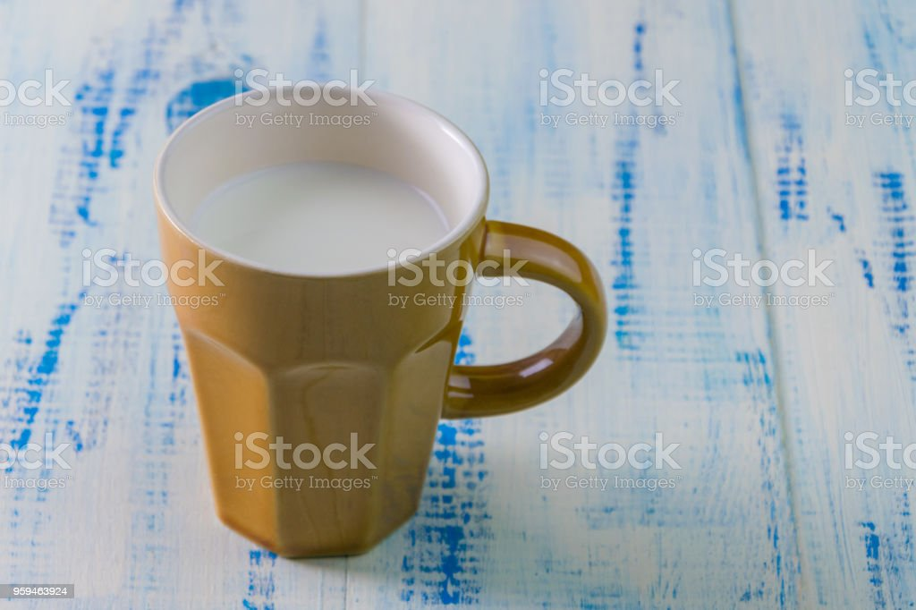 Cup with milk on a wooden background. stock photo