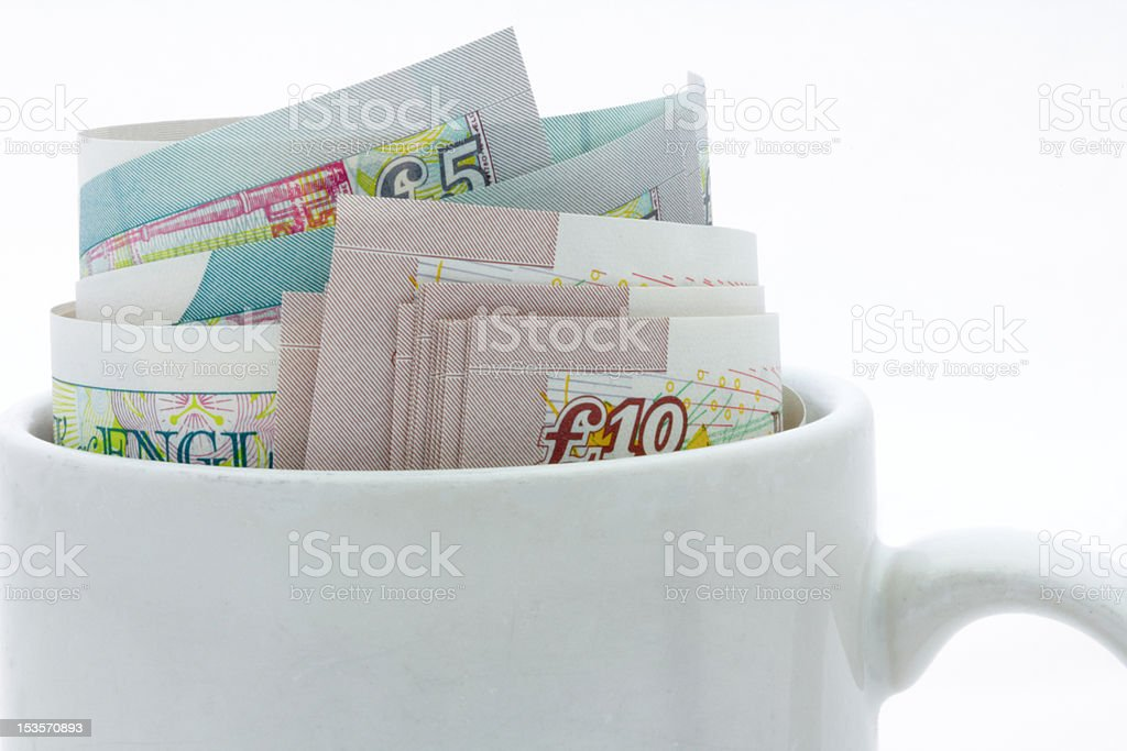 cup with money stock photo