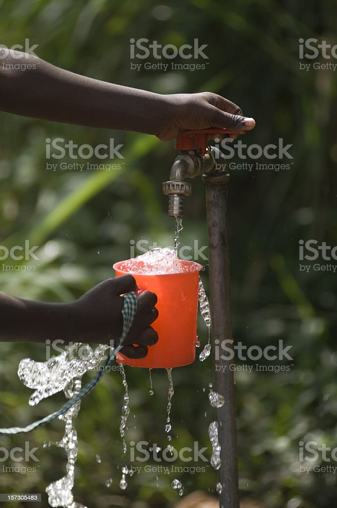 Cup with overflowing water stock photo