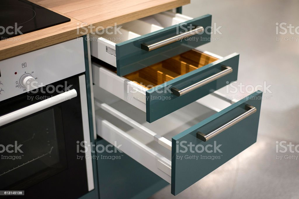 Cupboard With Opened Empty Drawers stock photo