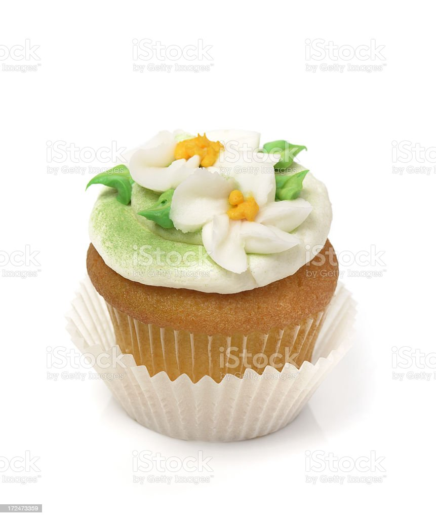 Cupcake decorated with buttercream icing flowers royalty-free stock photo