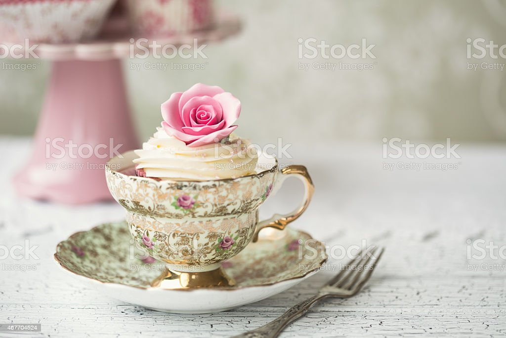 Cupcake in a vintage teacup stock photo